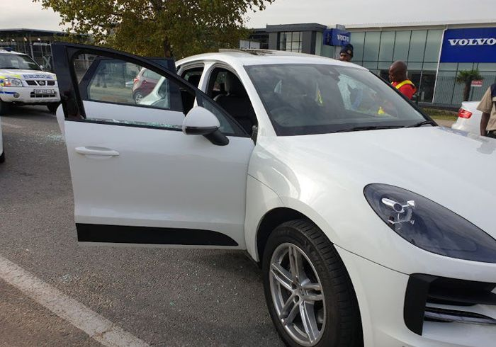 Woman Driving A Porsche SUV Shot at in Robbery and Attempted Hijacking.